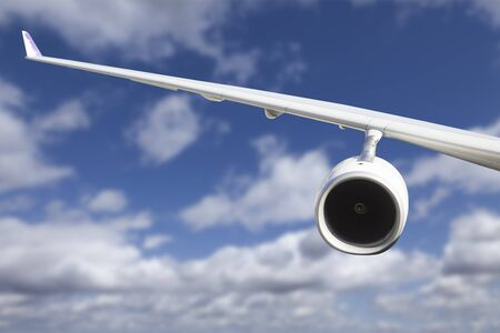 fixed wing aircraft: Large Airplane Wing Against Blue Sky and Clouds. Stock Photo