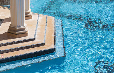 Exotic Luxury Swimming Pool Water and Architecture Abstract. Stock Photo