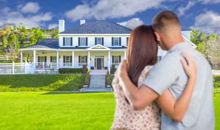 nice house: Affectionate Military Couple Looking at Nice New House.