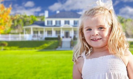blue eyed: Cute Smiling Girl Playing in Front Yard of House.