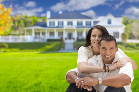 head home: Young Happy Hispanic Young Couple in Front of Their New Home. Stock Photo