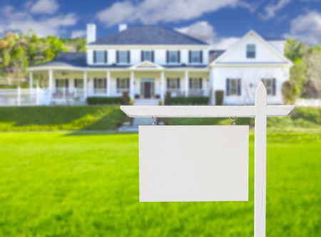 Blank Real Estate Sign in Front of Beautiful New House. Stock Photo - 35575218
