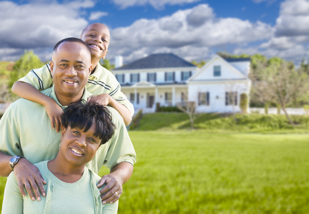 Happy African American Family In Front of Beautiful House. photo