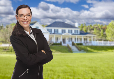 front house: Attractive Mixed Race Woman in Front of Beautiful New Residential House.