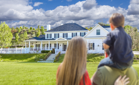 outdoor  outside: Mixed Race Young Family Looking At Beautiful New Home.