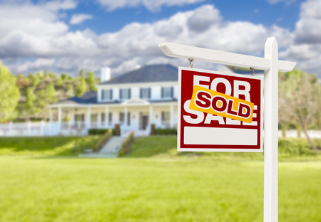 first home: Sold Home For Sale Real Estate Sign in Front of Beautiful New House. Stock Photo