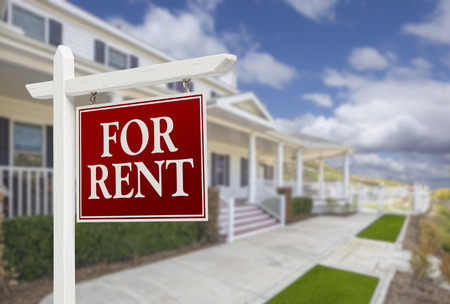 Red For Rent Real Estate Sign in Front of Beautiful House. Stockfoto