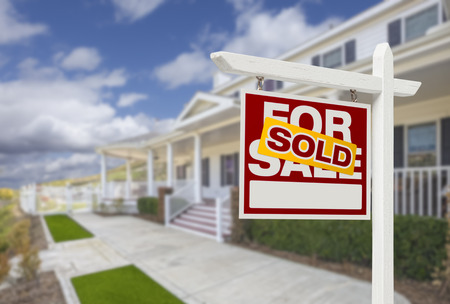 Sold Home For Sale Real Estate Sign and Beautiful New House. Banque d'images