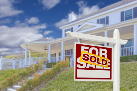sales agent: Sold Home For Sale Real Estate Sign and Beautiful New House. Stock Photo