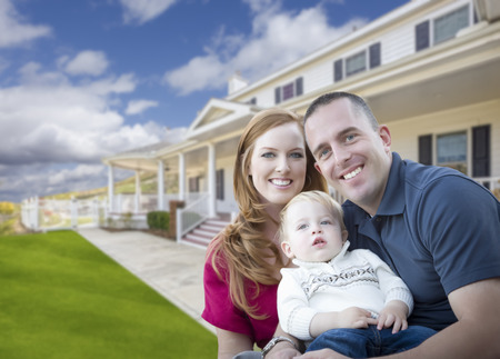 first home: Happy Young Military Family in Front of Their Beautiful House.