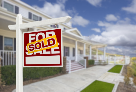 sale sign: Sold Home For Sale Real Estate Sign and Beautiful New House. Stock Photo