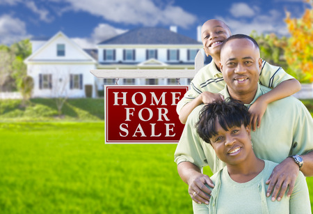 7 9 years: Happy African American Family In Front of For Sale Real Estate Sign and House. Stock Photo
