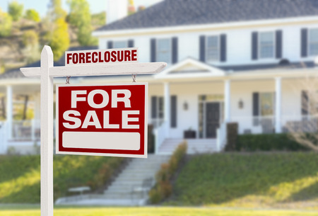 Foreclosure Home For Sale Real Estate Sign in Front of Beautiful Majestic House. Banco de Imagens