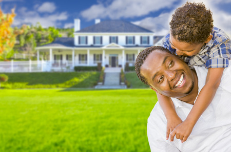 7 9 years: Happy Playful African American Father and Mixed Race Son In Front of House.