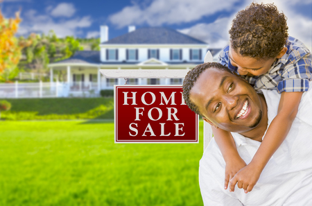 7 9 years: Happy Mixed Race Father and Son In Front of For Sale Real Estate Sign and New House. Stock Photo