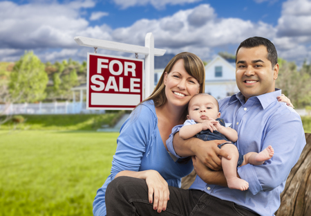 multi family house: Happy Young Mixed Race Family in Front of For Sale Real Estate Sign and New House.
