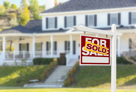 house sale: Sold Home For Sale Real Estate Sign in Front of Beautiful New House. Stock Photo
