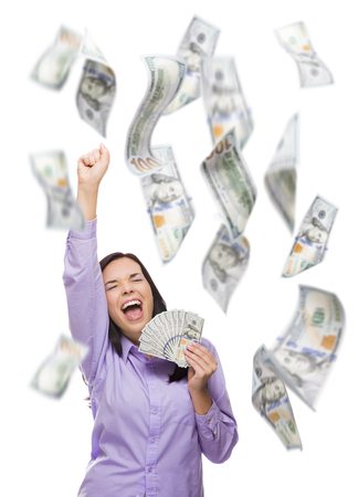 woman holding money: Celebrating Young Woman Holding $100 Bills with Many Others Falling Around Her on White. Stock Photo
