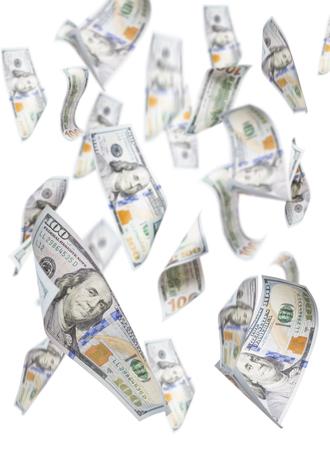 Willekeurig Falling One Hundred Dollar Bills geïsoleerd op een witte achtergrond. Stockfoto