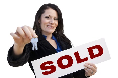 homebuyer: Smiling Hispanic Woman Holding Sold Real Estate Sign and Keys Isolated On White. Stock Photo
