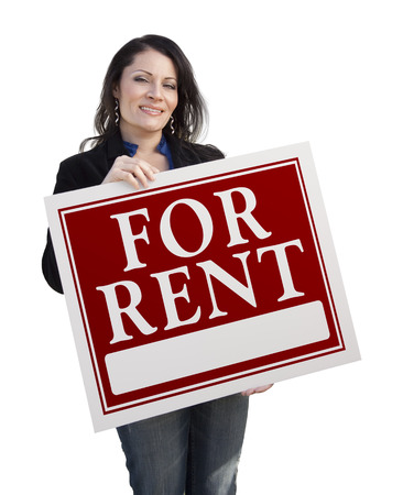 for rent sign: Smiling Hispanic Woman Holding For Rent Sign Isolated On White. Stock Photo