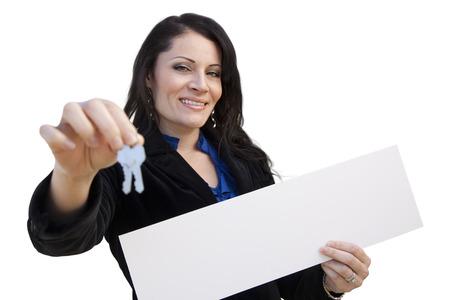 homebuyer: Smiling Hispanic Woman Holding Blank Sign and Keys Isolated On White.