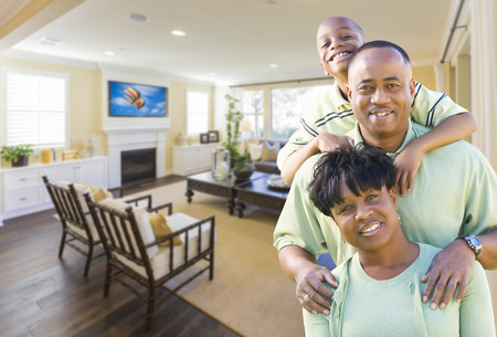 custom home: Happy Young African Amercian Family In Their Living Room.