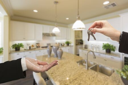 custom built: Handing Over New House Keys Inside Beautiful Custom Built Kitchen.