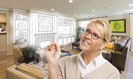 remodel: Creative Woman with Pencil Over Custom Living Room and Design Drawing. Stock Photo