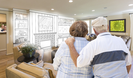 looking over: Senior Couple Looking Over Custom Living Room Design Drawing and Photo Combination.