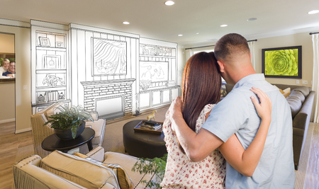 Young Military Couple Inside Custom Room and Design Drawing Combination. photo