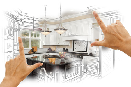 Female Hands Framing Custom Kitchen Design Drawing and Photo Combination. Stockfoto