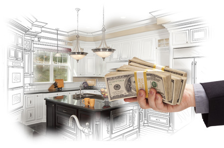 depiction: Hand Holding Stacks of Money Over Custom Kitchen Design Drawing and Photo Combination.