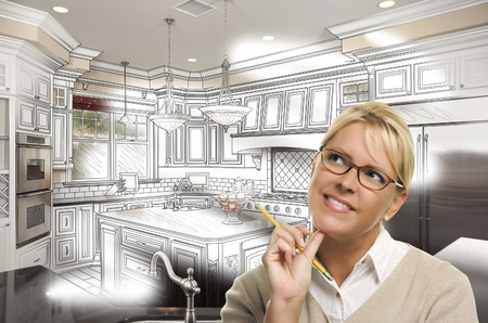 designers: Creative Woman With Pencil Over Custom Kitchen Design Drawing and Photo Combination on White.