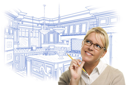 Daydreaming Woman With Pencil Over Custom Kitchen Design Drawing Isolated on White. Stock Photo