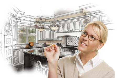 kitchen remodelling: Creative Woman With Pencil Over Custom Kitchen Design Drawing and Photo Combination on White.