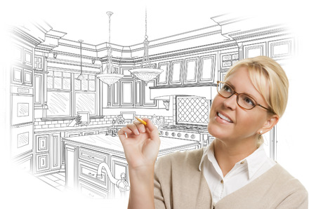 kitchen remodelling: Creative Woman With Pencil Over Custom Kitchen Design Drawing on White. Stock Photo