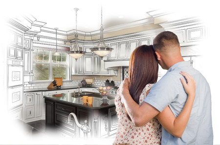 custom home: Young Military Couple Looking Inside Custom Kitchen and Design Drawing Combination.