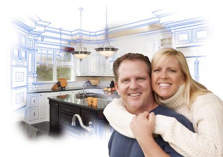 幸せなカップルはカスタム キッチン図面と白の背後にある写真と抱き締めます。
