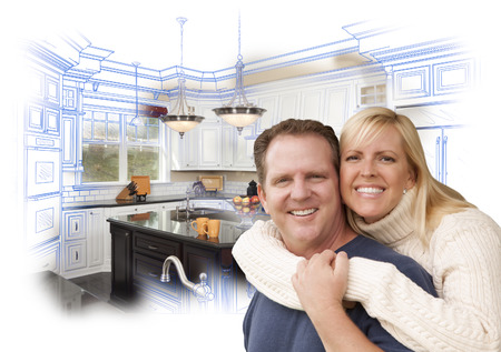 house construction: Happy Couple Hugging with Custom Kitchen Drawing and Photo Behind on White. Stock Photo