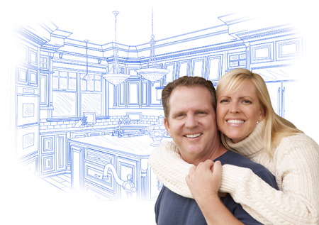 home owner: Happy Couple Hugging with Custom Kitchen Drawing Behind on White.