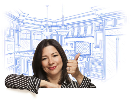 thumb's up: Happy Hispanic Woman with Thumbs Up and Custom Kitchen Drawing Behind on White. Stock Photo