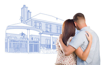 mixed race girl: Embracing Military Couple Looking At House Drawing on White. Stock Photo