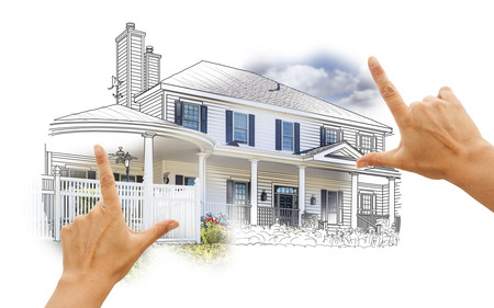 home construction: Hands Framing House Drawing and Photo Combination on White. Stock Photo