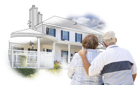 retire: Curious Embracing Senior Couple Looking At  House Drawing and Photo Combination on White. Stock Photo