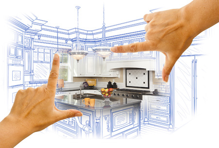 hand with pencil: Female Hands Framing Custom Kitchen Design Drawing and Photo Combination. Stock Photo