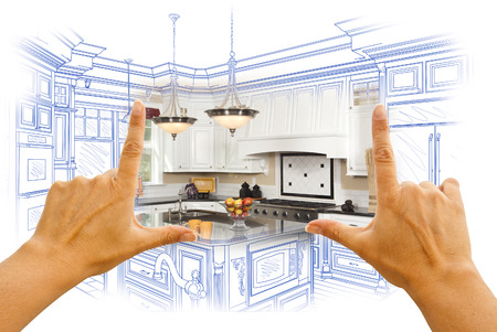 my home: Female Hands Framing Custom Kitchen Design Drawing and Photo Combination. Stock Photo