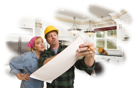 discussing: Male Contractor in Hard Hat Discussing Plans with Woman, Kitchen Photo Behind.