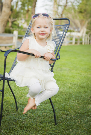 blue eyed: Cute Playful Baby Girl Portrait Outside at the Park. Stock Photo