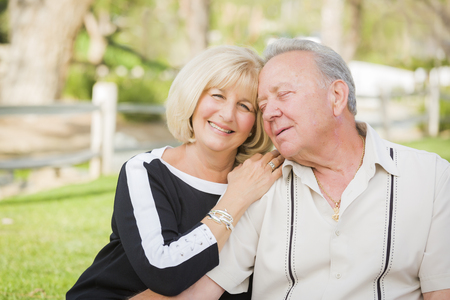 happy old age: Affectionate Senior Couple Portrait Outside At The Park.